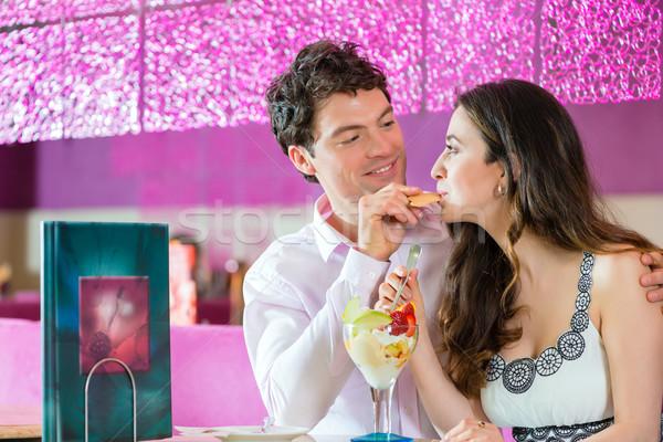 Young couple enjoying their time in ice cream parlor Stock photo © Kzenon