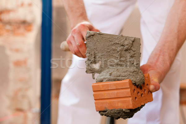 Stock photo: Bricklayer working on construction site