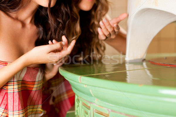 Two young women doing wellness with herb fragrance Stock photo © Kzenon