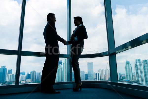 Asian business people shaking hands Stock photo © Kzenon