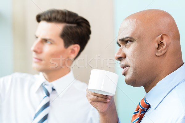 Two business people having informal coffee meeting Stock photo © Kzenon