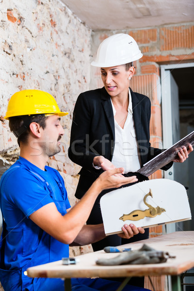 Construction worker and interior designer with door Stock photo © Kzenon