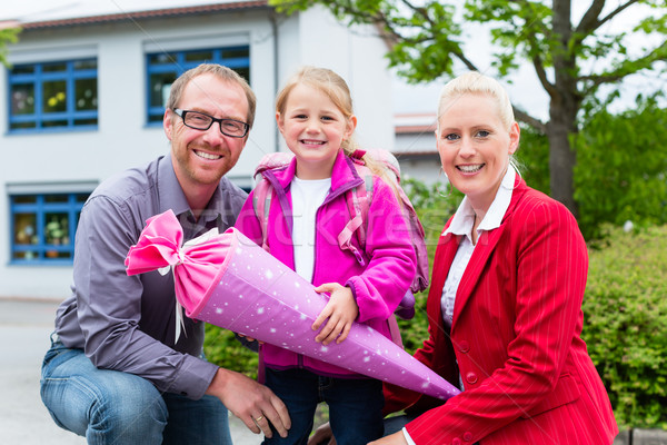 Family bringing daughter to first day at school  Stock photo © Kzenon