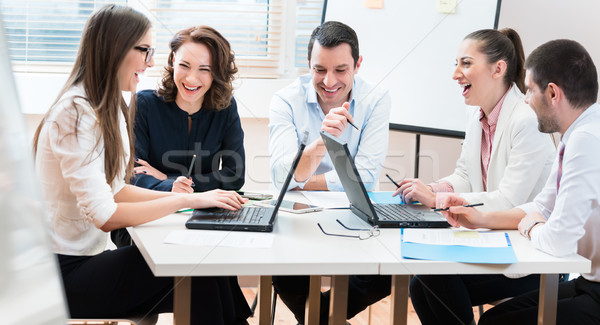 Business people, women and men, negotiating agreement Stock photo © Kzenon