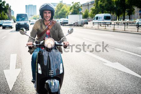 Tourist in Berlin riding scooter Stock photo © Kzenon