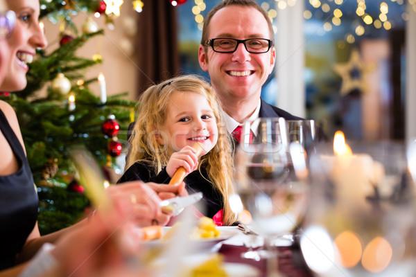 Family eating Christmas dinner at home Stock photo © Kzenon