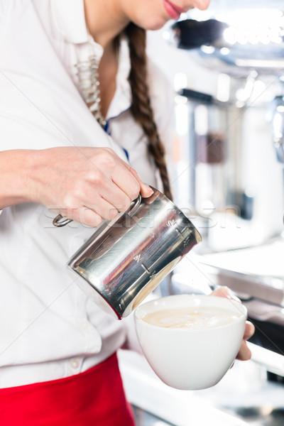 Közelkép kezek pincérnő áramló tej kávé Stock fotó © Kzenon