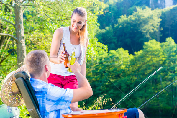Couple of woman and man having beer while sport fishing Stock photo © Kzenon