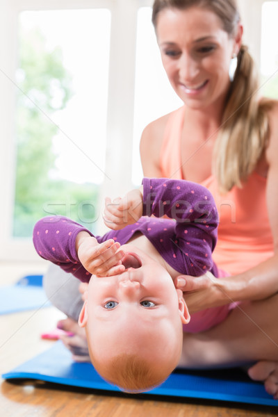 Stock photo: Mum and her baby child in pregnancy recovery course