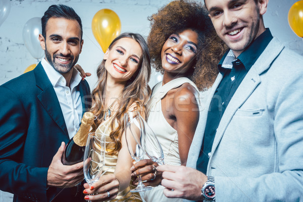 Party people with drinks celebrating new year or a birthday party Stock photo © Kzenon