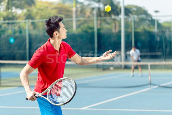 Kínai teniszező kész labda adag tenisz Stock fotó © Kzenon