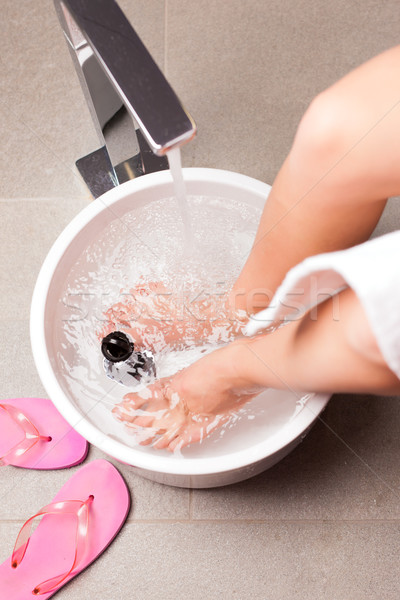Woman having hydrotherapy water footbath Stock photo © Kzenon