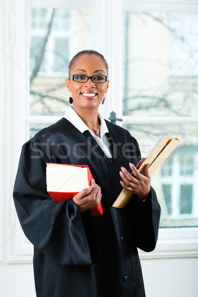Lawyer in office with law book and Dossier Stock photo © Kzenon