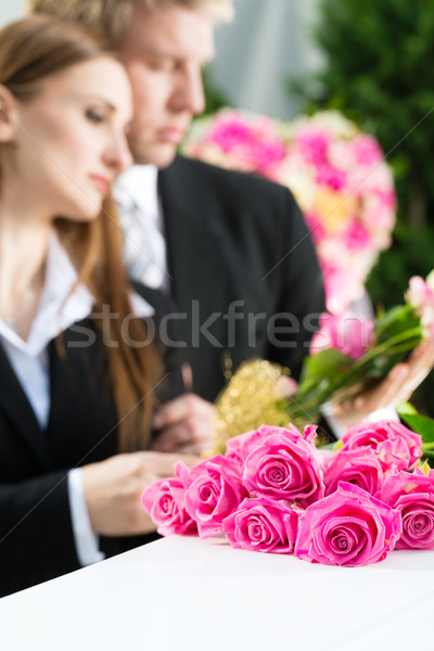Mourning People at Funeral with coffin Stock photo © Kzenon