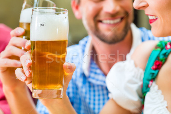 Young people in Bavarian Tracht in restaurant or pub Stock photo © Kzenon