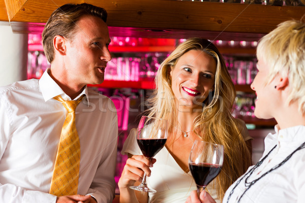Man and two women in hotel bar Stock photo © Kzenon