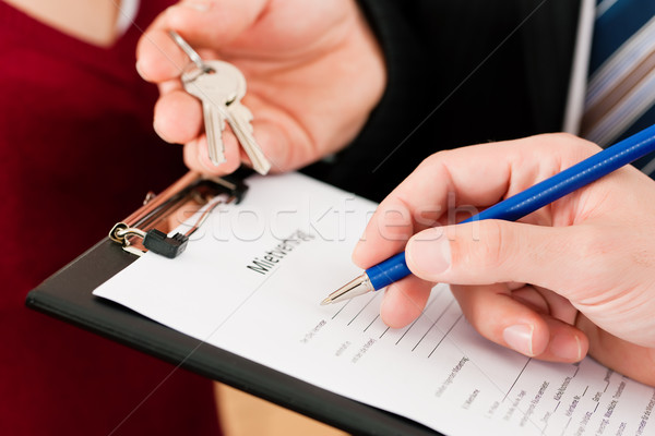 Signing tenant agreement Stock photo © Kzenon