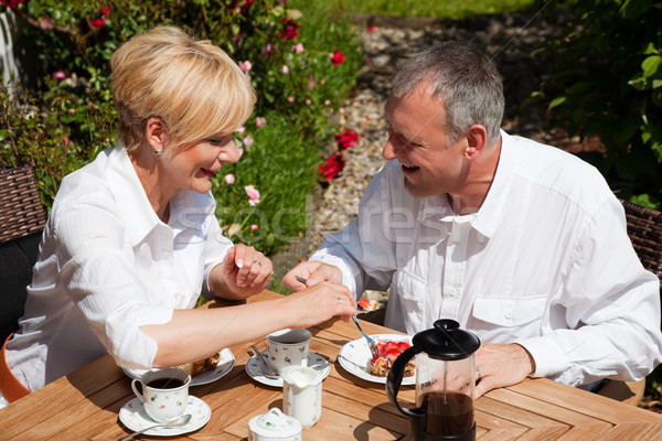 Mature couple having coffee on porch Stock photo © Kzenon