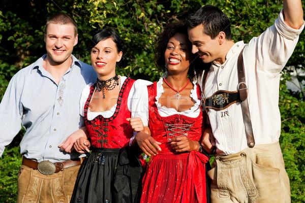 Group of four friends in Bavarian Tracht Stock photo © Kzenon