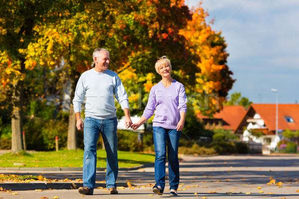 Jesienią spadek spaceru strony starszy para Zdjęcia stock © Kzenon