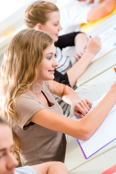 Stock photo: Students writing a test in school concentrating