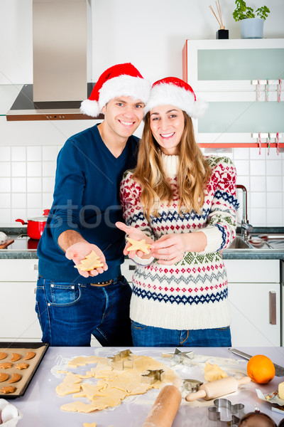 Couple baking Christmas cookies in kitchen Stock photo © Kzenon