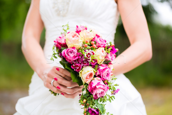 Bride in gown with bridal bouquet  Stock photo © Kzenon