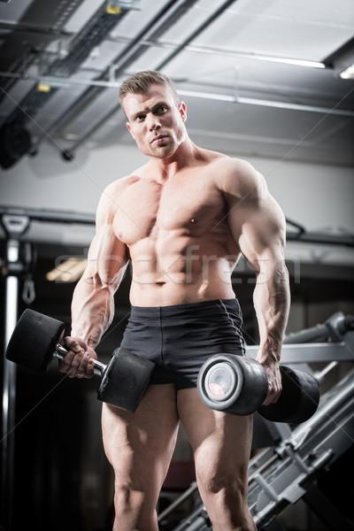 Bodybuilder palestra fitness formazione piedi Foto d'archivio © Kzenon