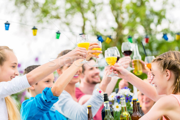 Friends and neighbors toasting on garden party Stock photo © Kzenon