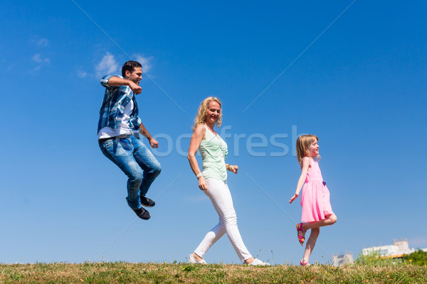 Mom and daughter walk in single file, on is jumping Stock photo © Kzenon