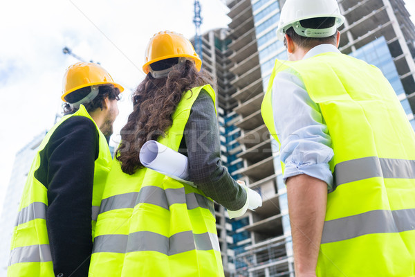 építkezés mérnökök épület helyszín toronyház férfi Stock fotó © Kzenon