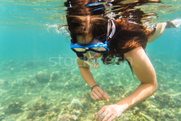 Girl in bikini snorkelling in tropical sea Stock photo © Kzenon
