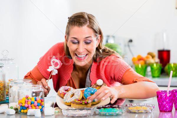 女性 キャンディ スティック ピッキング ドーナツ ストックフォト © Kzenon