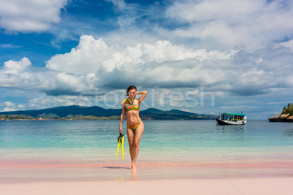 Beautiful young woman holding snorkeling equipment at Pink Beach Stock photo © Kzenon