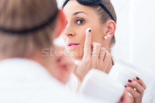 Woman removing her makeup before sleeping Stock photo © Kzenon