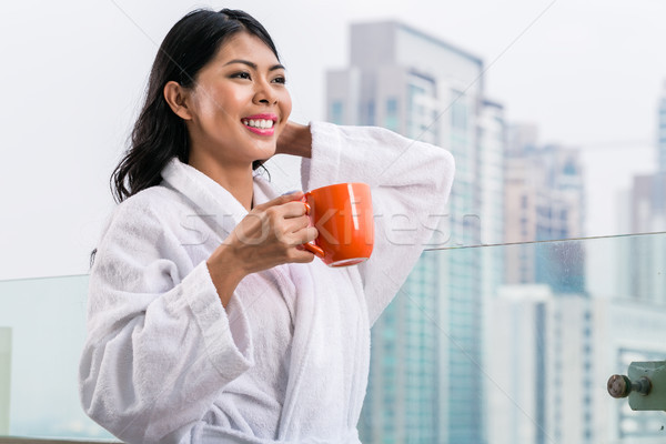 Stock photo: Asian woman in morning front of city skyline