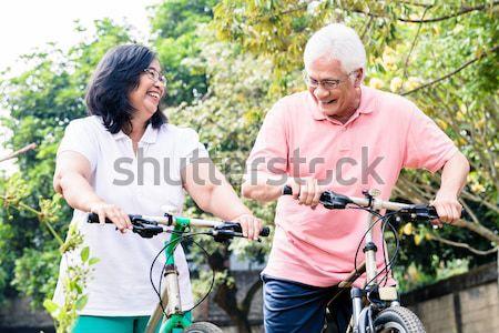Idős feleség üveg víz férj biciklizik Stock fotó © Kzenon