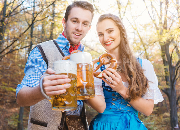 Woman and man in Bavarian Tracht drinking beer Stock photo © Kzenon