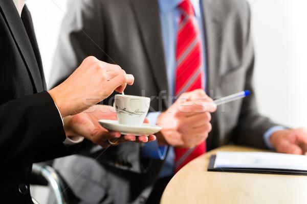 businesspeople in business office drink coffee Stock photo © Kzenon