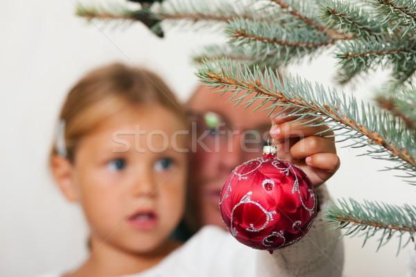 Child decorating the Christmas tree Stock photo © Kzenon