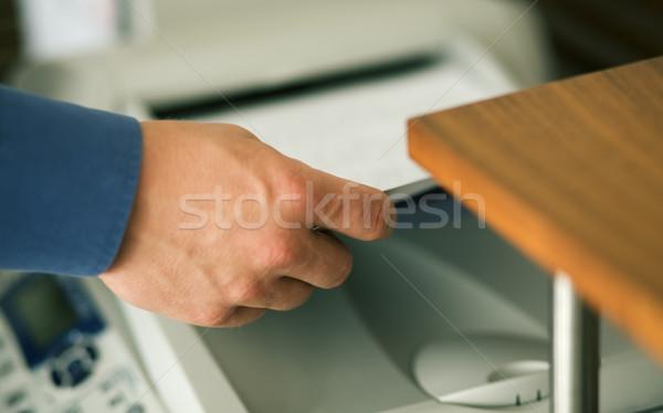 Valami férfi kéz köteg papír elvesz Stock fotó © Kzenon