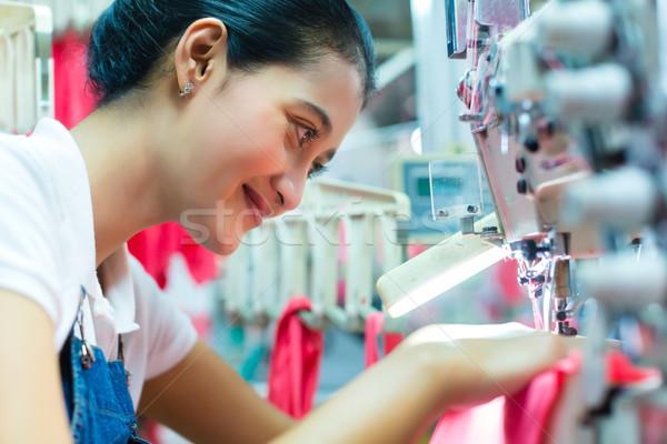 Indonesian Seamstress in Asian textile factory Stock photo © Kzenon