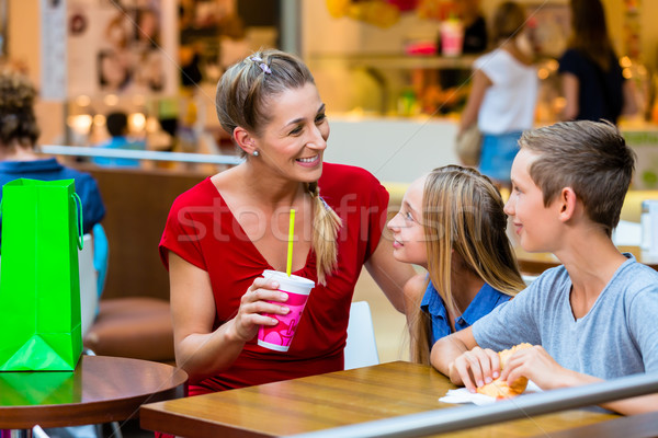 Family eating and drinking in cafe at shopping mall Stock photo © Kzenon