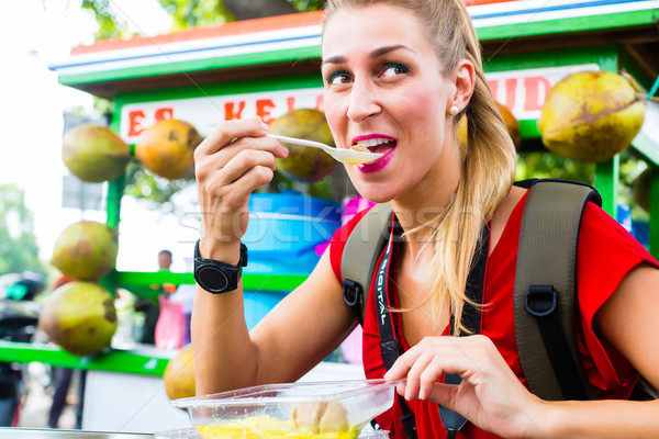 Tourist eating food at Indonesian street kitchen Stock photo © Kzenon