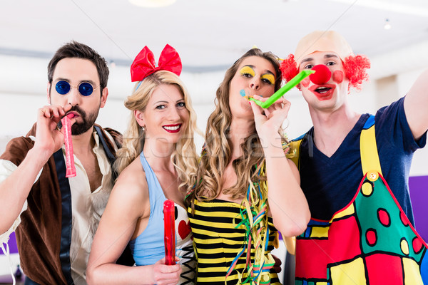 Party people celebrating carnival or new years eve Stock photo © Kzenon