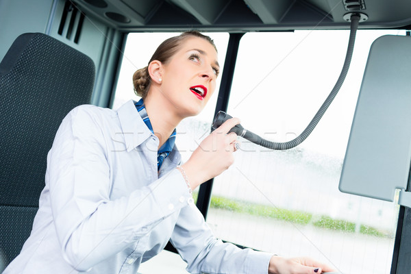 Bus driver woman speaking into the microphone Stock photo © Kzenon