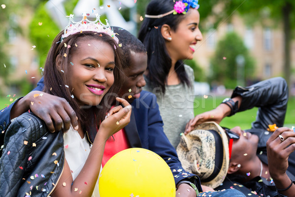 Stock photo: Indian girl and african couple celebrating together on street pa