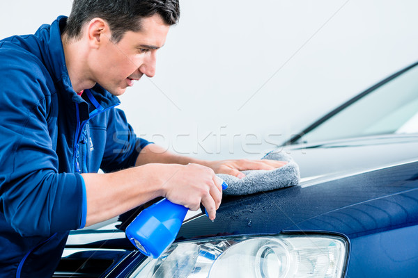 Proud car owner cleaning his vehicle Stock photo © Kzenon