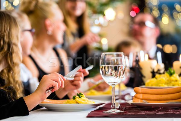 Family having Christmas dinner sausages  Stock photo © Kzenon