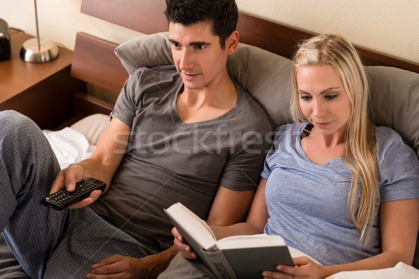 Young couple with different hobbies Stock photo © Kzenon